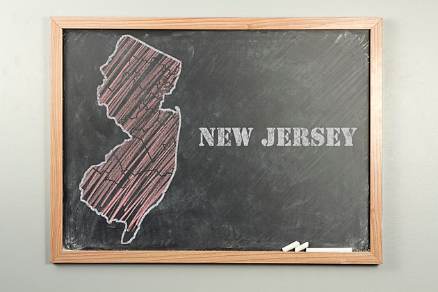 Outlined New Jersey US state on grade school chalkboard
