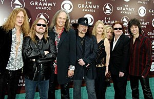 Members of the band Lynyrd Skynyrd pose as they arrive to the 47th Annual Grammy Awards