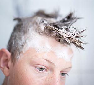 Teenaged Boy Taking A Shower