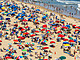 Crowded beach covered with umbrellas