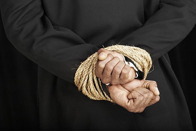 Man with hands bound